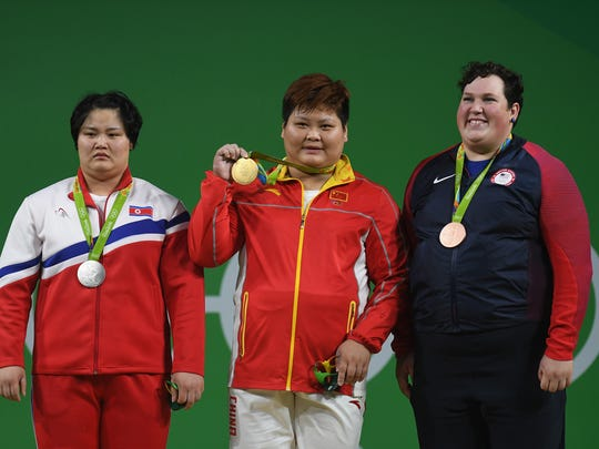 (L-R) Silver medalist Kuk Hyang Kim of North Korea,  Gold medalist Suping Meng of China and bronze medalist Sarah Elizabeth Robles of the United States pose on the podium during the medal ceremony for  the Weightlifting - Women's +75kg Group A on Day 9 of the Rio 2016 Olympic Games at Riocentro - Pavilion 2 on August 14, 2016 in Rio de Janeiro, Brazil.  (Photo by Laurence Griffiths/Getty Images)