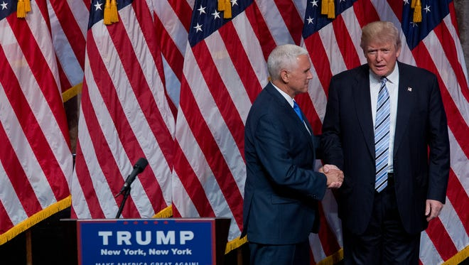Republican presidential candidate Donald Trump, right, and Gov. Mike Pence, R-Ind., shake hands during a campaign event to announce Pence as the vice presidential running mate on, Saturday, July 16, 2016, in New York. In their first joint appearance, Trump tried to draw a sharp contrast between Pence, a soft-spoken conservative, and Hillary Clinton, the Democratic presidential candidate.