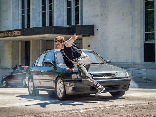 Baby (Ansel Elgort) feels the music when chased by