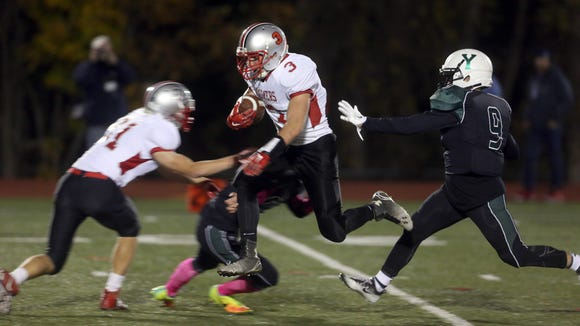 Matthew Pires of Somers gets airborne on his way to