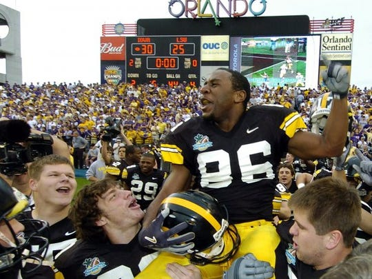 Iowa receiver Warren Holloway is carried off the field on the shoulders of his teammates after scoring his first collegiate touchdown on a 56-yard pass on the final play to give Iowa a 30-25 win in the Capital One Bowl over Louisiana State in Orlando, Fla., Saturday, Jan. 1, 2005.