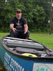 Bennie Giles, a retired Army veteran, is canoeing the