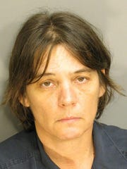 Margaret Williams is charged with unlawfully using