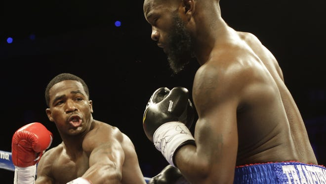 Adrien Broner throws a punch at Emmanuel Taylor during their fight at U.S. Bank Arena last September.