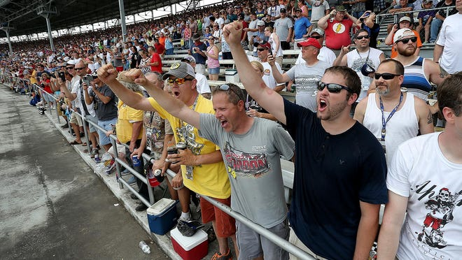 NASCAR fans cheer on their favorite drivers at the start of Sunday's Jeff Kyle 400 at the Brickyard.