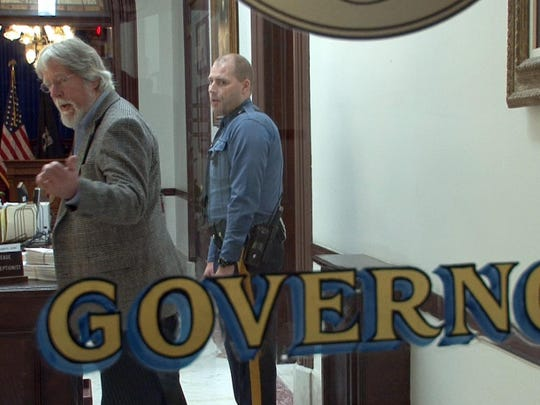 Asbury Park Press Editorial Page Editor Randy Bergmann is turned away at Gov. Chris Christie's Statehouse office in Trenton Oct. 29 after he tried to drop off letters and petitions to encourage political leaders to cut property taxes.