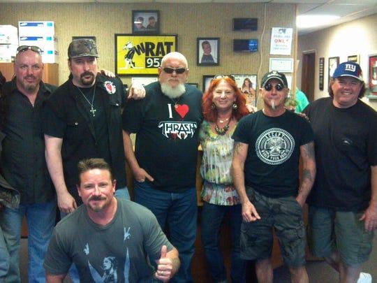 "The Old Bridge Metal Militia in 2013, from left: Keith Roth; Pete Perrina; Danny Anniello, Ray Dill (kneeling); Jonny Zazula; Marsha Zazula; Mark Tornillo and ""Metal"" Joe Chimmenti."