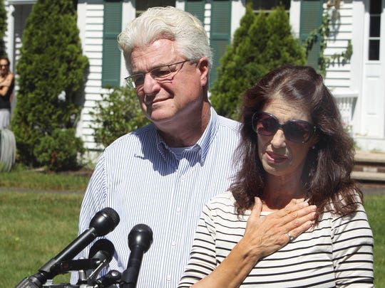Diane and John Foley talk to reporters after speaking with U.S. President Barack Obama Wednesday, Aug. 20, outside their home in Rochester, N.H.  Their son, James Foley was abducted in November 2012 while covering the Syrian conflict. Islamic militants posted a video showing his murder on Tuesday and said they killed him because the U.S. had launched airstrikes in northern Iraq.