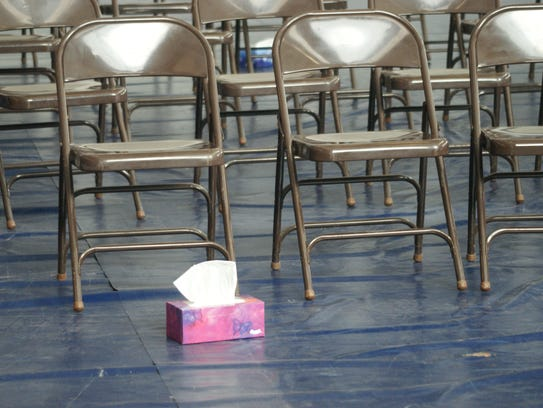 A single box of tissue left behind after the memorial