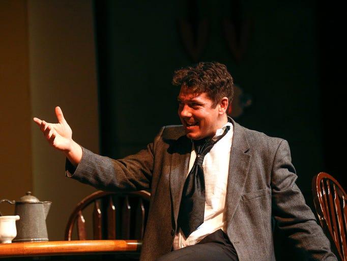 Actor Mark Burnham rehearses a scene from the Theater