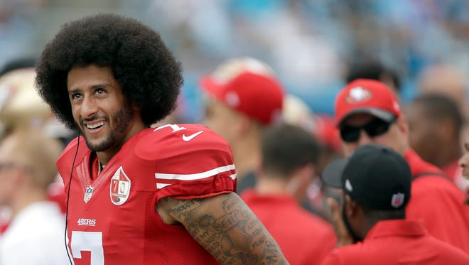 San Francisco 49ers' Colin Kaepernick stands on the sidelines during the first half of an NFL football game against the Carolina Panthers in Charlotte, N.C., on Sept. 18.