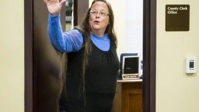 Kim Davis waves at her Kentucky office.
