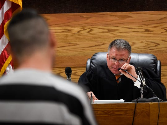 Circuit Court Judge Duane Slone questions an inmate about his opioid use in court Dec. 13, 2016, in Sevierville, Tenn. Slone has seen the opioid crisis balloon from the time he took the bench in 1989 until now.
