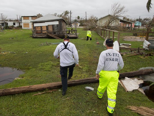 Members of Texas Task Force One search a home on Live