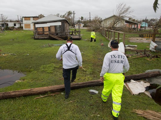 Members of Texas Task Force One search a home on Live Oak Street in Rockport a day after Hurricane Harvey made landfall. (Sunday, Aug. 27, 2017)