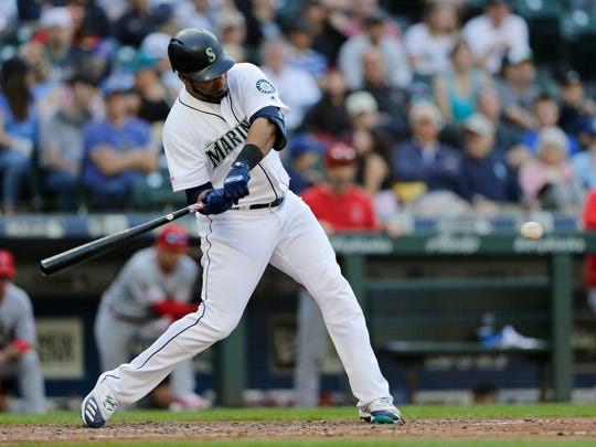 Seattle Mariners' Edwin Encarnacion swings into a pitch from Los Angeles Angels starting pitcher Andrew Heaney for a two-run home run during the sixth inning of a baseball game Saturday, June 1, 2019, in Seattle. (AP Photo/John Froschauer)