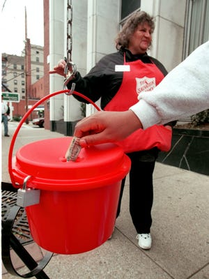 Salvation Army bell ringer Melanie Lease works a kettle outside a bank in Morgantown, W.Va., in 1998. The kettle has received an anonymous donation of a $1,000 bill since 1972.