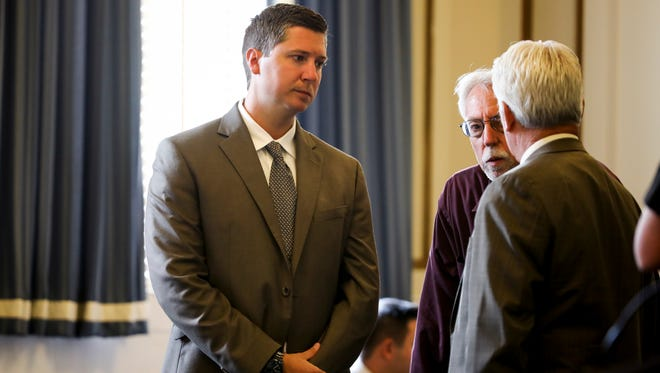 Former University of Cincinnati police officer Raymond Tensing, left, speaks with his lawyer, Stew Mathews, right, before the start of the fifth day of Tensing's retrial in Hamilton County Common Pleas Judge Leslie Ghiz's courtroom Wednesday, June 14, 2017, in Cincinnati.