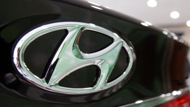 FILE - In this July 26, 2012 file photo, the logo of Hyundai Motor Co. is seen on its car at the company's showroom in Seoul. Hyundai is recalling 173,000 Sonata midsize cars in the U.S., on April 8, 2016,  because the power steering can fail, making them harder to steer and increasing the risk of a crash. The recall covers Sonatas from the 2011 model year when the car was Hyundai's top-selling U.S. vehicle.   (AP Photo/Ahn Young-joon, File)