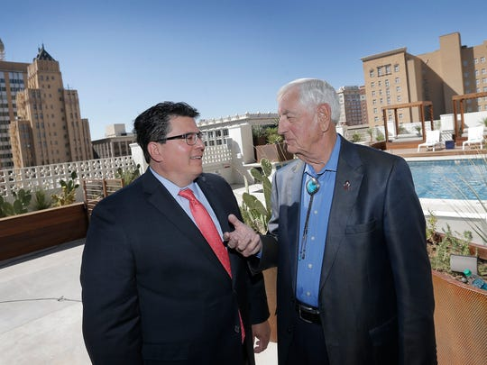 Borderplex Alliance CEO Rolando Pablos, left, talks with Garrey Carruthers, New Mexico State University president and former New Mexico governor, after a news conference last month at Hotel Indigo in Downtown El Paso.