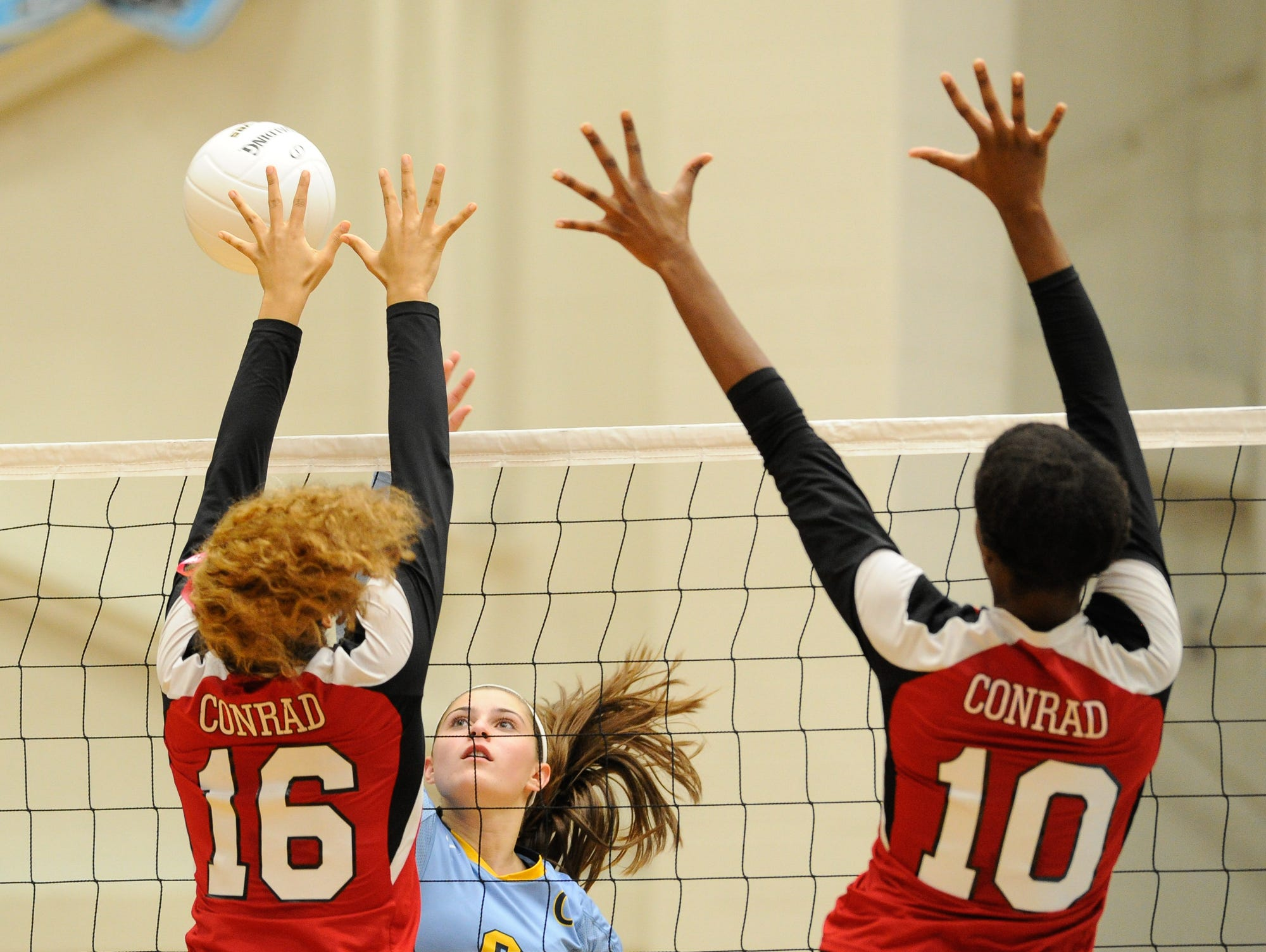 Cape's #6 Alison Palmer with a spike in the second game against Conrad Thursday night at Cape Henlopen High School.