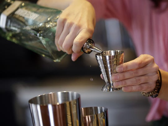 Julia Petiprin makes a drink at Sundry and Vice.