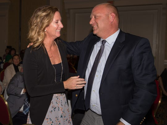 DJ Forcucci hugs his wife, Virginia, after she was named Delaware's 2018 Teacher of the Year.