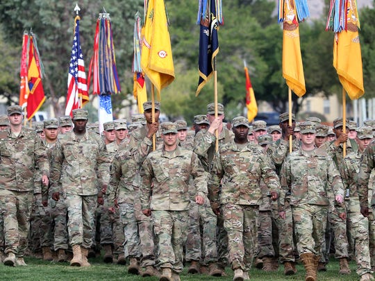 Fort Bliss soldiers pass in review during a change of command ceremony for the commander of the 1st Armored Division and Fort Bliss on post.