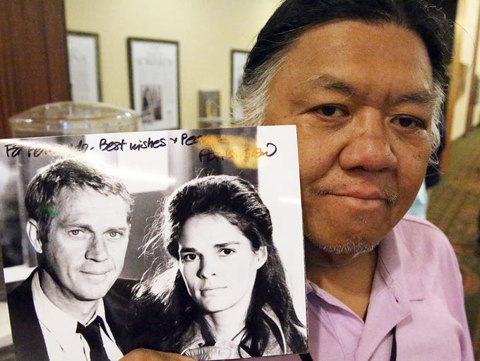 Fernie Mabini shows a signed photograph of Ali MacGraw
