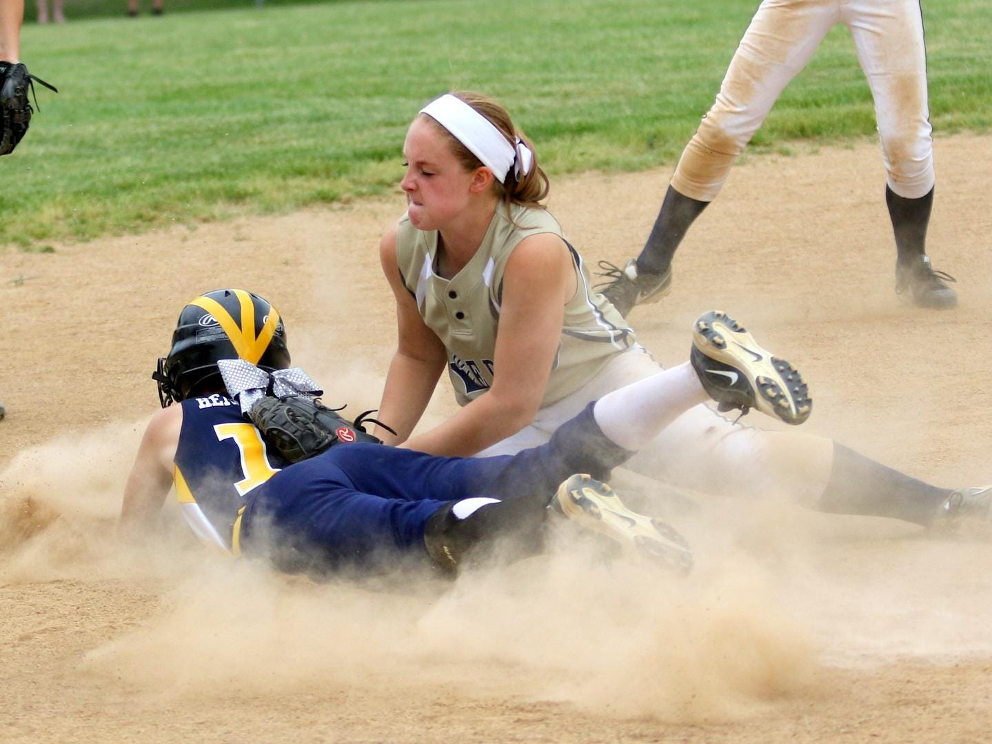 Notre Dame third baseman Makenzie Maloney tags out Tioga's Paige Hendershot during this season's Section 4 Class C softball final at the BAGSAI Complex. Maloney earned second-team Class C all-state honors.