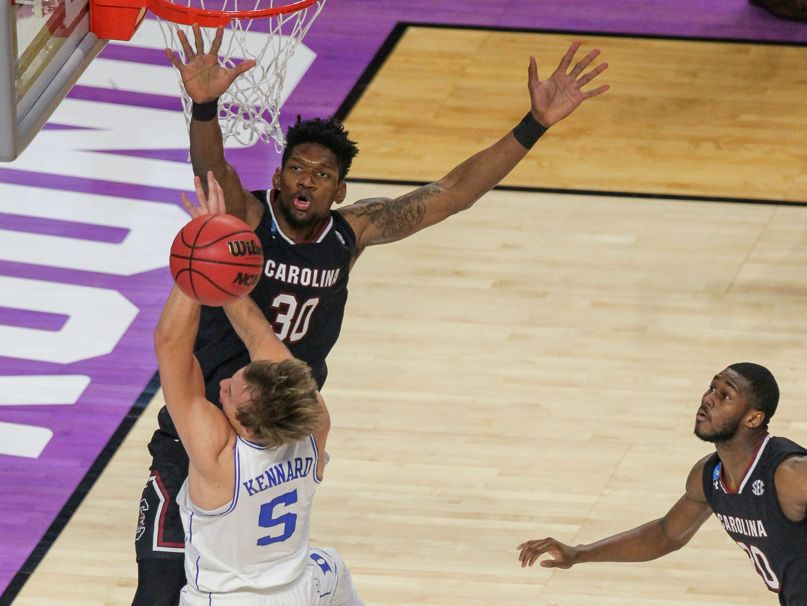 South Carolina forward Chris Silva (30) defends Duke guard Luke Kennard in the first half during the 2nd round of the NCAA Tournament at Bon Secours Wellness Arena in downtown Greenville on Sunday, March 19, 2017.