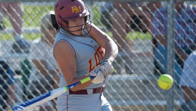 Dani Young of Rocky Mountain High School takes a swing at the ball during a game against Poudre High School Thursday, September 24, 2015. The Lobos defeated the Impalas 9-6.