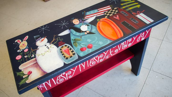 An acrylic-on-wood painted bench decorated in the American-style