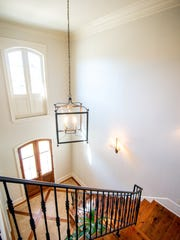 Soaring ceilings and a grand staircase grace the foryer of the home.