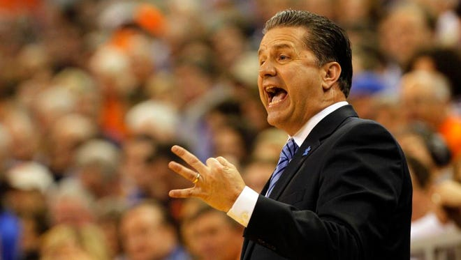 Feb 7, 2015; Gainesville, FL, USA; Kentucky Wildcats head coach John Calipari reacts against the Florida Gators during the first half at Stephen C. O'Connell Center. Mandatory Credit: Kim Klement-USA TODAY Sports