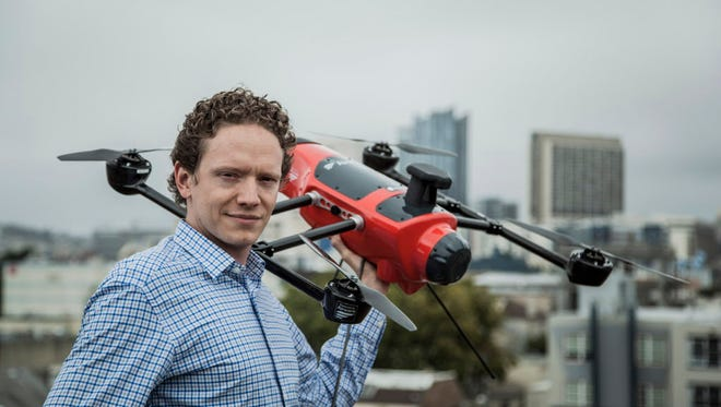 Jonathan Downey, 32, founder and CEO of Airware, is photographed with a Delta drone on the roof of the Airware offices in San Francisco's SOMA neighborhood on July 9, 2015.