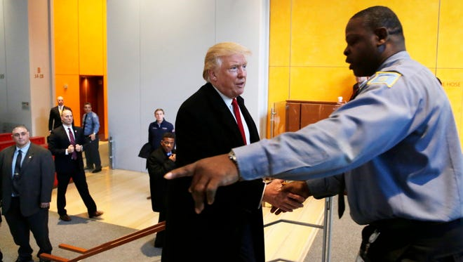 President-elect Donald Trump shakes hands with New York Times security guard Thomas Price on Nov. 22, 2016.