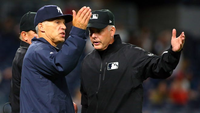 Yankees manager Joe Girardi has a discussion with first base umpire Tim Timmons during a recent game against the Cardinals at Yankee Stadium.