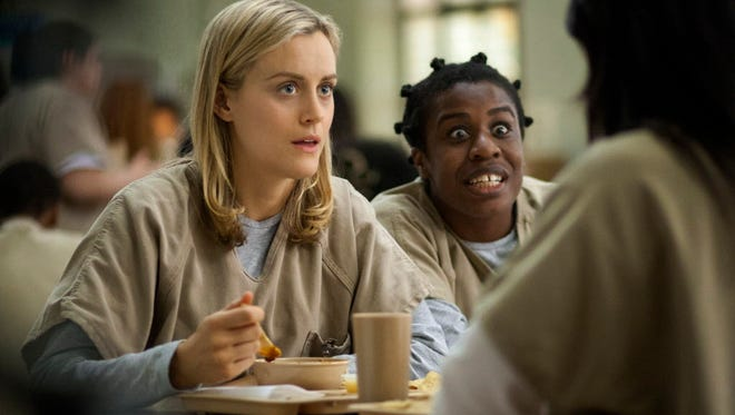 """Taylor Schilling, left, and Uzo Aduba are two of the many stars of Netflix's """"Orange Is the New Black."""""""