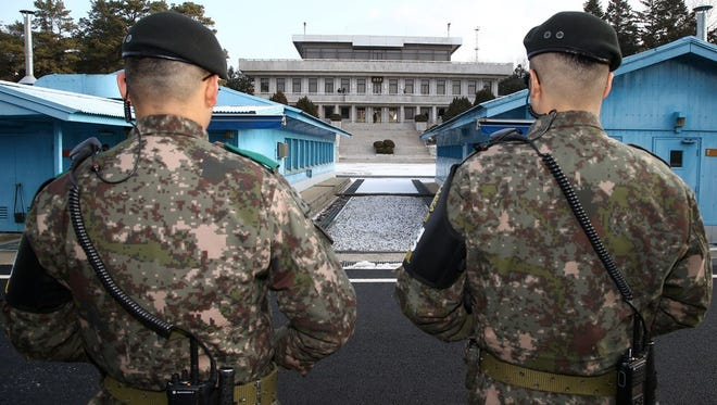 South Korean soldiers stand guard during a high level inter-Korean meeting at the border village of Panmunjom, on Jan. 9.