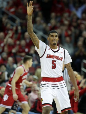 Louisville's Malik Williams holds up three fingers after scoring his third three pointer in the first half. Dec. 9, 2017.