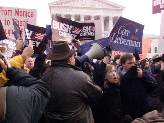 Hundreds of protesters demonstrate in front of the Supreme Court prior to arguments before the court by lawyers for Al Gore and George Bush on Dec. 11, 2000.
