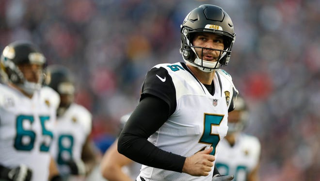 Jacksonville Jaguars quarterback Blake Bortles (5) runs off the field after the second quarter against the New England Patriots in the AFC Championship Game at Gillette Stadium. Mandatory Credit: Greg M. Cooper-USA TODAY Sports