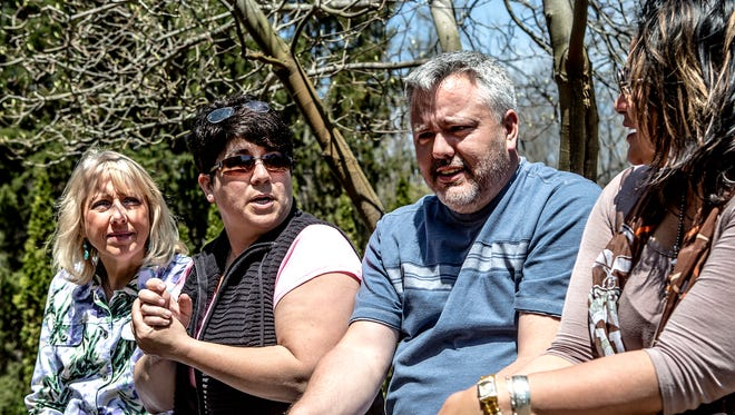 Debbie and Gerald Russell, center, talk about the night they were stabbed at the Nazareth restaurant in February. The Johnstown couple has relied on each other and the those in the community to help them through their recovery. Comedian Mary Miller, left, and friend, Patch Wetzel, right, have organized a benefit for the Russells this Saturday night in Johnstown.