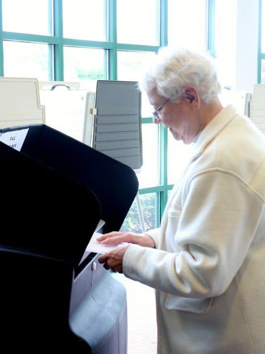 636379175886887968-voting-woman.jpg