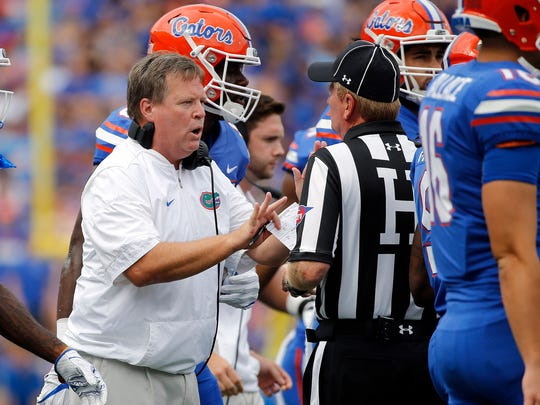 Sep 16, 2017; Gainesville, FL, USA; Florida Gators head coach Jim McElwain talks with an official during the first quarter against the Tennessee Volunteers at Ben Hill Griffin Stadium. Mandatory Credit: Kim Klement-USA TODAY Sports