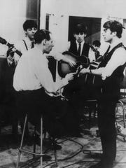 George Martin, seated, during an early recording session