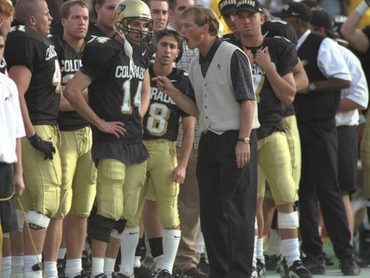 Colorado head coach Rick Neuheisel works the sidelines