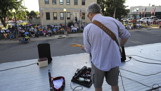 Shawn Beaver plays a sweet solo with Ted Hobbs and Friends at Friday Night on the Square in Mountain Home last year.