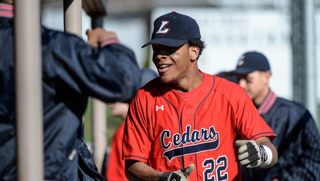 Lebanon's Jorge Garcia is congratulated in the dugout after scoring as Lebanon held off Northern Lebanon to win 3-2 at Coleman Memorial Park on Tuesday, April 5, 2016